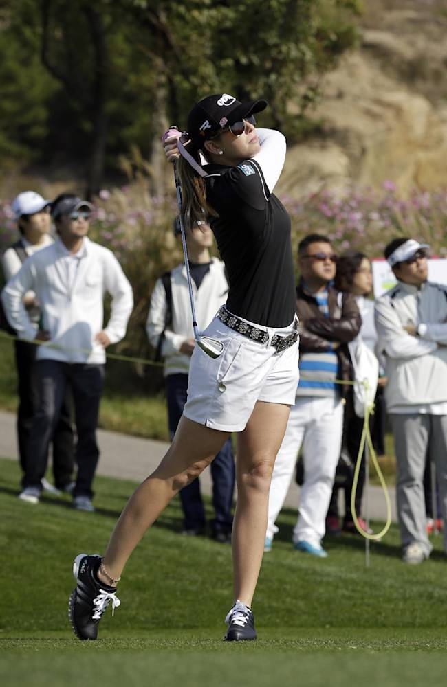Paula Creamer of the United States watches her shot on the seventh hole during the first round of the LPGA KEB Hana Bank Championship golf tournament at Sky72 Golf Club in Incheon, west of Seoul, South Korea, Friday, Oct. 18, 2013
