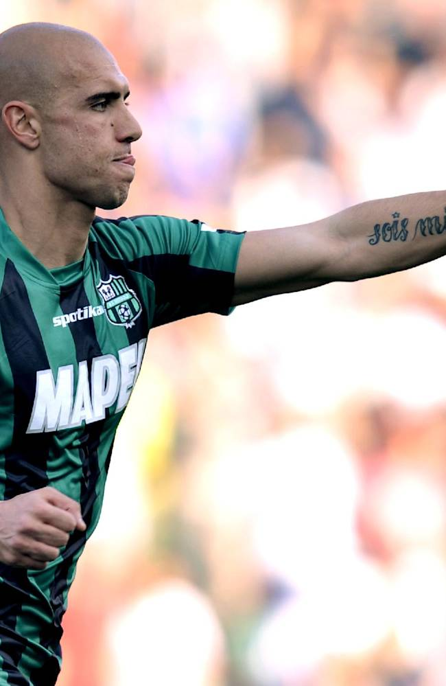 Sassuolo's Simone Zaza celebrates after scoring a goal during a Serie A soccer match against AC Milan, at Reggio Emilia's Mapei stadium, Italy, Sunday, Jan. 12, 2013