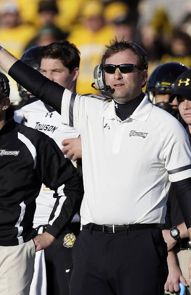 Towson head coach Rob Ambrose signals to his team in the second half of the FCS championship NCAA college football game against North Dakota State, Saturday, Jan. 4, 2014, in Frisco, Texas. NDSU won 35-7