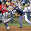 Tampa Bay Rays third baseman Evan Longoria, right, throws to second to force out Minnesota Twins Alex Presley to end the inning, as Twins Jermaine Mitchell (80) tries to advance, on a ground out by Brian Dozier in the second inning of an exhibition baseba