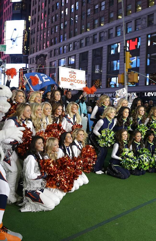 Seattle Seahawks Sea Gals cheerleaders and Denver Broncos cheerleaders are joined by Miles, the Broncos mascot, and Blitz, the Seahawks mascot, Friday, Jan. 31, 2014 during a live broadcast of Good Morning America at Times Square in New York. The Seattle Seahawks will play the Broncos Sunday in the NFL Super Bowl XLVIII football game in East Rutherford, N.J
