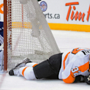 Philadelphia Flyers' Mark Streit (32) lies on the ice after having his shot saved by Toronto Maple Leafs goalie Jonathan Bernier during the third period of an NHL hockey game, Saturday, March 8, 2014 in Toronto The Associated Press