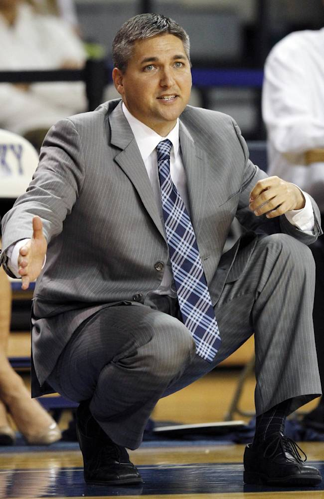 Eckerd's Paul Honsinger directs his team during the first half of an NCAA college basketball exhibition game against Kentucky, Sunday, Nov. 3, 2013, in Lexington, Ky