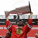 Chicago Blackhawks' Brandon Saad holds up the Stanley Cup during a rally celebrating the NHL hockey club's Stanley Cup championship, Thursday, June 18, 2015, at Soldier Field in Chicago. (AP Photo/Nam Y. Huh)
