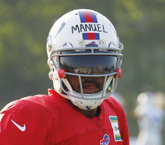 Buffalo Bills quarterback EJ Manuel (3) takes part in drills during NFL football training camp in Pittsford, N.Y., Tuesday, July 22, 2014