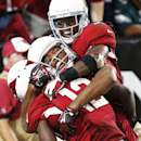 Arizona Cardinals John Brown, left, celebrates with Larry Fitzgerald and Andre Ellington after catching the winning touchdown pass against the Philadelphia Eagles during the second half of an NFL football game, Sunday, Oct. 26, 2014, in Glendale, Ariz. Th