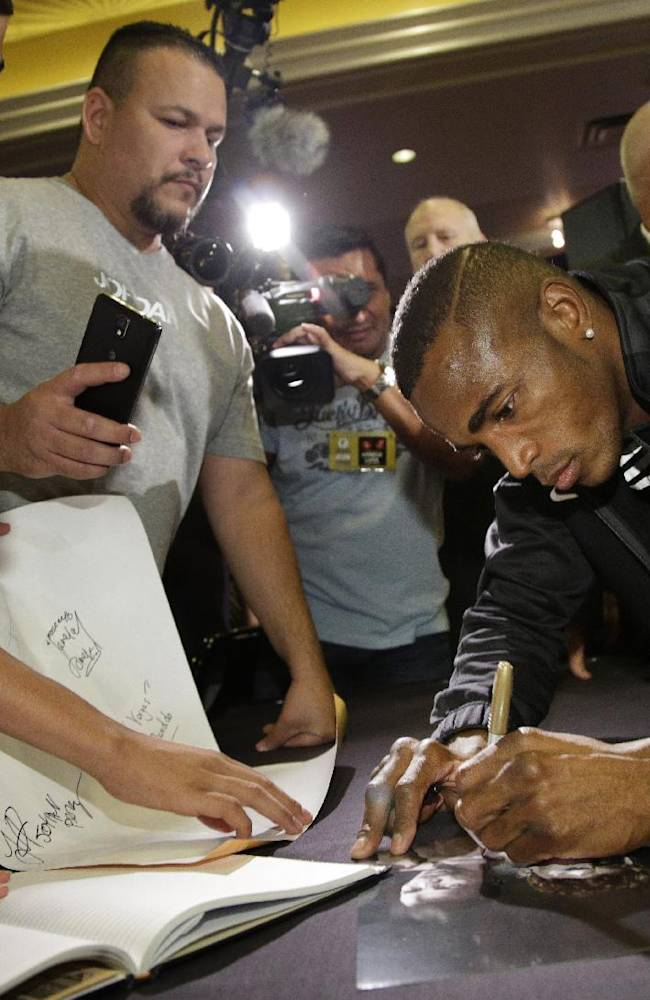 Boxer Erislandy Lara signs autographs Wednesday, July 9, 2014, in Las Vegas. Lara is scheduled to fight Canelo Alvarez in a super welterweight boxing fight Saturday in Las Vegas