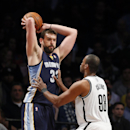 Brooklyn Nets center Jason Collins (98) guards Memphis Grizzlies center Marc Gasol (33) in the second half of an NBA basketball game on Wednesday, March 5, 2014, in New York. Brooklyn won 103-94 The Associated Press