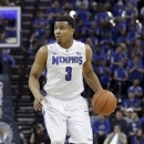 Memphis' Chris Crawford (3) moves the ball up court during the first half of an NCAA college basketball game against Southern Miss in Memphis, Tenn., Saturday, Feb. 23, 2013. Crawford scored 19 points in Memphis' 89-73 victory. (AP Photo/Danny Johnston)