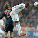 Bayern's Thomas Mueller, left, and Manchester City's Fernandinho, right, challenge for the ball during the Champions League group D soccer match between FC Bayern Munich and Manchester City, in Munich, southern Germany, Tuesday, Dec. 10, 2013