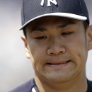 New York Yankees starting pitcher Masahiro Tanaka reacts as he walks off the mound at the end of the second innings of an exhibition baseball game against the Minnesota Twins in Fort Myers, Fla., Saturday, March 22, 2014 The Associated Press