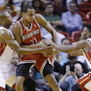 Milwaukee Bucks center John Henson (31) tries to regain control of the ball from Miami Heat forward James Jones (22) and guard Norris Cole (30) during the first half of an NBA basketball game on Wednesday, April 2, 2014, in Miami The Associated Press