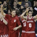 Indiana forward Will Sheehey (0) reacts with teammates on the bench during the first half of an NCAA college basketball game against Iowa, Monday, Dec. 31, 2012, in Iowa City, Iowa. (AP Photo/Charlie Neibergall)