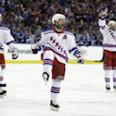 New York Rangers right wing Martin St. Louis, center, celebrates after scoring a goal during the third period of Game 4 of the Eastern Conference finals against the Tampa Bay Lightning, in the NHL hockey Stanley Cup playoffs, Friday, May 22, 2015, in Tampa, Fla. (AP Photo/Chris O'Meara)