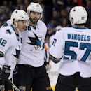 San Jose Sharks' Patrick Marleau (12), Brent Burns (88) and Tommy Wingels (57) celebrate after Burns scored against the Winnipeg Jets during the first period of an NHL hockey game Monday, Jan. 5, 2015, in Winnipeg, Manitoba The Associated Press