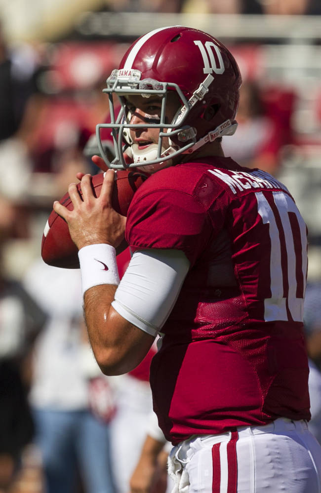 Alabama quarterback AJ McCarron (10) warms up before an NCAA college football game against Georgia State on Saturday, Oct. 5, 2013, in Tuscaloosa, Ala