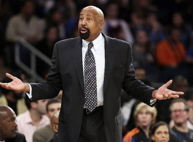 New York Knicks' Mike Woodson argues a call during the first half of an NBA basketball game against the Toronto Raptors, Friday, Dec. 27, 2013, in New York