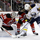 Buffalo Sabres center Cody Hodgson, right, is double teamed by New Jersey Devils goalie Cory Schneider (35) and center Travis Zajac during the first period of an NHL hockey game, Saturday, Nov. 30, 2013, in Newark, N.J The Associated Press