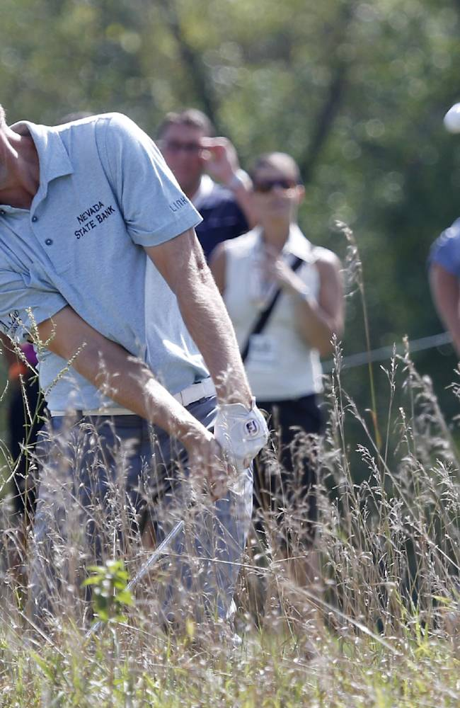 John Merrick hits out of the rough on the ninth fairway during the first round of the BMW Championship golf tournament at Conway Farms Golf Club in Lake Forest, Ill., Thursday, Sept. 12, 2013