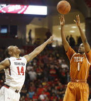 Texas' Isaiah Taylor shoots over Texas Tech's Robert Turner during their NCAA college basketball game in Lubbock, Texas, Saturday, Mar, 8, 2014. (AP Photo/Lubbock Avalanche-Journal, Zach Long)