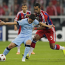 Manchester City's Samir Nasri, left, and Bayern's Mehdi Benatia, right, challenge for the ball during the Champions League Group E soccer match between FC Bayern Munich and Manchester City at Allianz Arena in Munich, southern Germany, Wednesday Sept. 17,