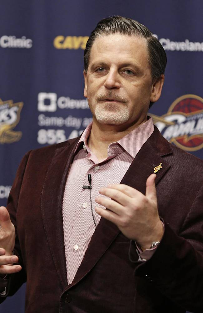 Cleveland Cavaliers owner Dan Gilbert answers questions before the Cavaliers' NBA basketball game against the Brooklyn Nets on Wednesday, Oct. 30, 2013, in Cleveland