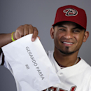 Arizona Diamondbacks right fielder Gerardo Parra holds up a sign with his name and number during photo day for the team before spring training baseball workouts Wednesday, Feb. 19, 2014, in Scottsdale, Ariz The Associated Press
