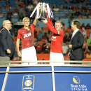 IMAGE DISTRIBUTED FOR GUINNESS INTERNATIONAL CHAMPIONS CUP - Manchester United's Darren Fletcher, left and Wayne Rooney hold the 2014 Guinness International Champions Cup after they defeated Liverpool, on Monday, August 4, 2014 in Miami Gardens, FL. (Doug
