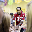 Atlanta Falcons' Steven Jackson leads a cheer with students at Shiloh Point Elementary School as part of the NFL's Play 60 Campaign to encourage kids to get 60 minutes of exercise a day, Tuesday, Dec. 3, 2013, in Cumming, Ga. Jackson addressed a special a