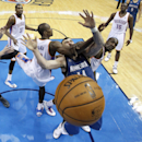 Minnesota Timberwolves center Nikola Pekovic, middle, is defended by Oklahoma City Thunder forward Serge Ibaka, left, and center Kendrick Perkins in the fourth quarter of an NBA basketball game in Oklahoma City, Sunday, Dec. 1, 2013. Perkins was called