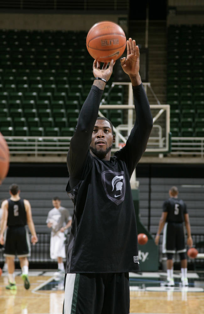 Michigan State's Branden Dawson warms up following the team's NCAA college basketball media day, Tuesday, Oct. 22, 2013, in East Lansing, Mich