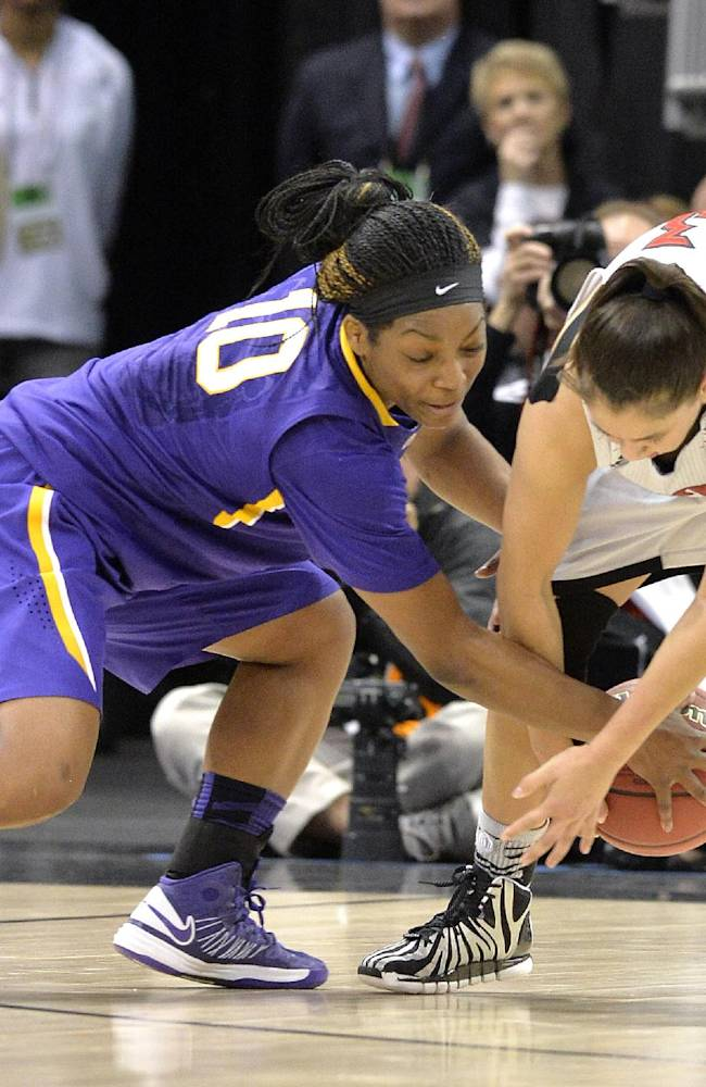 LSU's Jasmine Rhodes, left, battles Louisville's Shoni Schimmel for a loose ball during the first half in a regional semifinal game at the NCAA women's college basketball tournament on Sunday, March 30, 2014, in Louisville, Ky