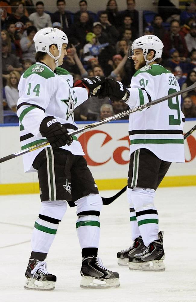 Dallas Stars' Tyler Seguin (91) congratulates Jamie Benn (14) after Benn scored against the New York Islanders in the first period of an NHL hockey game on Monday, Jan. 6, 2014, in Uniondale, N.Y