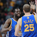Golden State Warriors forward Draymond Green, back, is congratulated by guard Steve blake after Green's shot to move the Warriors ahead by five points against the Denver Nuggets late in the fourth quarter of the Warriors' 116-112 victory in an NBA basketb