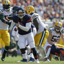 Chicago Bears quarterback Jay Cutler (6) scrambles for a first down against the Green Bay Packers in the first half of an NFL football game Sunday, Sept. 28, 2014, in Chicago. The Associated Press