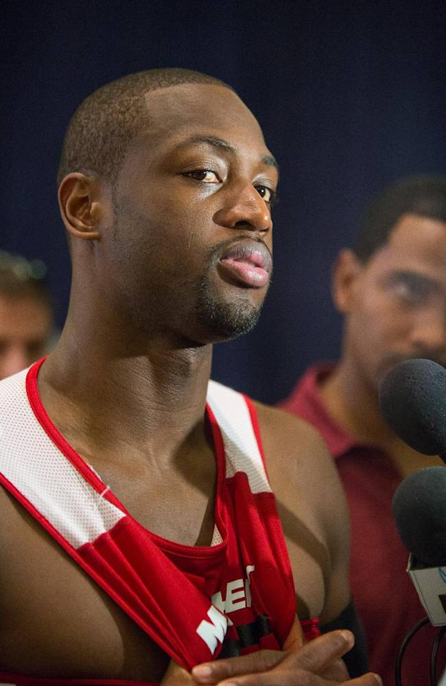 Miami Heat point guard Dwayne Wade speaks with reporters after training at the Atlantis resort on Paradise Island, Bahamas, Wednesday, Oct. 2, 2013. The two-time defending NBA champions are holding a one week training camp at the resort