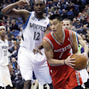 Houston Rockets' Jeremy Lin, right, looks to pass as he goes around Minnesota Timberwolves' Luc Mbah a Moute of Cameroon in the second half of an NBA basketball game, Monday, Feb. 10, 2014, in Minneapolis. The Rockets won 107-89 The Associated Press