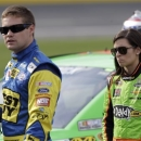 FILE - In this May 17, 2013 file photo, Danica Patrick, right, walks with Ricky Stenhouse Jr., left, on pit road during qualifying for the NASCAR Sprint Showdown auto race at Charlotte Motor Speedway in Concord, N.C. Patrick says there were some