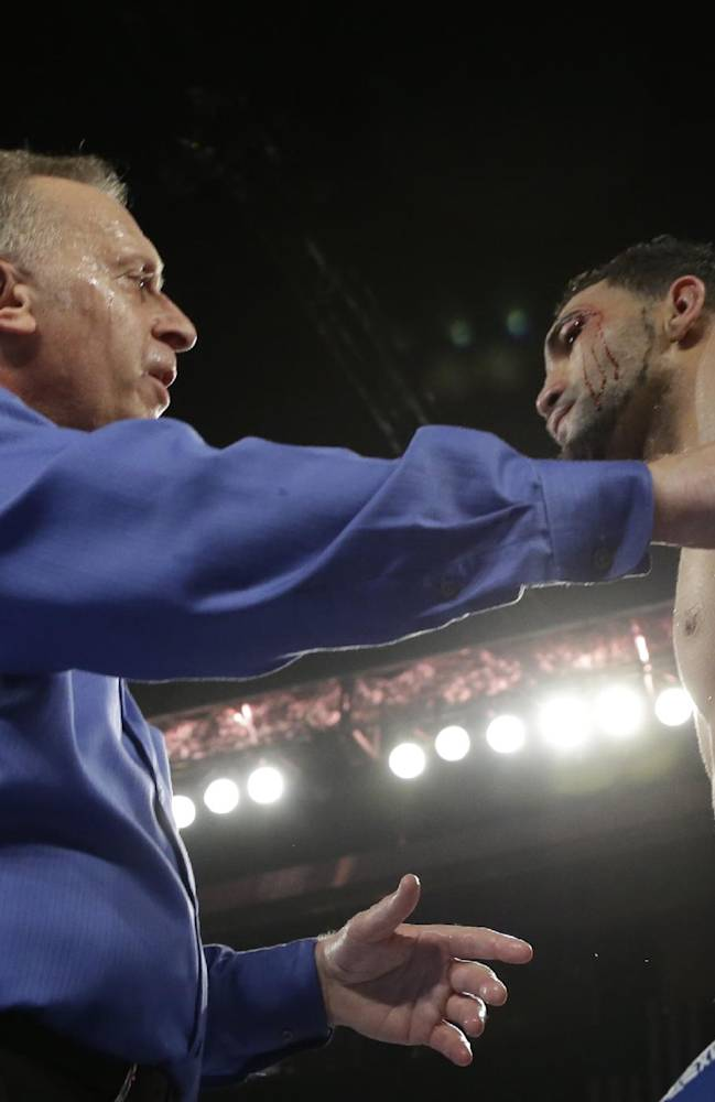 Referee jack Reiss takes a close look at a cut over the eye of Edwin Rodriguez, of the Dominican Republic, in the 11th round of his super middleweight championship boxing match against Andre Ward in Ontario, Calif., Saturday, Nov. 16, 2013. Ward won by unanimous decision