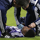 Anderlecht's Conte is attended to as lies on the ground injured during the Group D Champions League match between Anderlecht and Arsenal at Constant Vanden Stock Stadium in Brussels, Belgium, Wednesday Oct. 22, 2014
