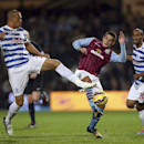Queens Park Rangers' Bobby Zamora, left, and Aston Villa's Ashley Westwood in action during the English Premier League soccer match at Loftus Road in London, Monday Oct. 27, 2014. (AP Photo / John Walton, PA)