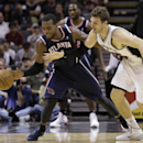 Atlanta Hawks' Paul Millsap, left, steals the ball from San Antonio Spurs' Tiago Splitter, right, of Brazil, during the second half of an NBA basketball game, Monday, Dec. 2, 2013, in San Antonio The Associated Press