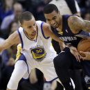 Golden State Warriors guard Stephen Curry, left, defends Memphis Grizzlies guard Courtney Lee during the second half of an NBA basketball game Friday, March 28, 2014, in Oakland, Calif. Golden State won 100-93 The Associated Press