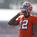 In this Aug. 4, 2014, file photo, Cleveland Browns wide receiver Josh Gordon rests during practice at the NFL football team's training campin Berea, Ohio. Gordon has been suspended by the NFL one year for violating the league's substance abuse policy. Gor