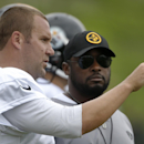 Pittsburgh Steelers quarterback Ben Roethlisberger, left, talks with head coach Mike Tomlin during NFL football training camp in Latrobe, Pa., on Wednesday, July 30, 2014 The Associated Press