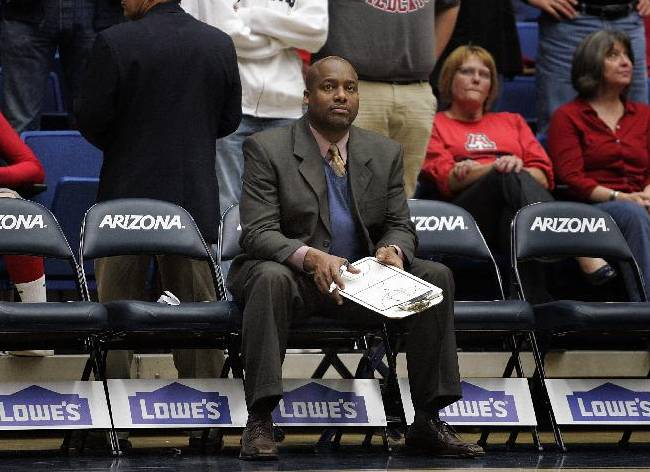 Southern University's head coach Roman Banks sits on the bench and waits for the second half of an NCAA college basketball game against Arizona to start on Thursday, Dec. 19, 2013, in Tucson, Ariz. Arizona won 69-43