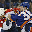 New York Islanders left wing Eric Boulton (36) fights with Florida Panthers right wing Krys Barch (21) during the first period of an NHL hockey game at Nassau Coliseum in Uniondale, N.Y., Sunday, March 2, 2014 The Associated Press