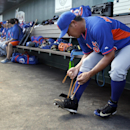 New York Mets pitcher Daisuke Matsuzaka ties his shoe before starting an exhibition spring training baseball game against the St. Louis Cardinals Sunday, March 2, 2014, in Jupiter, Fla. Matsuzaka allowed one run and two hits in two innings of work in the