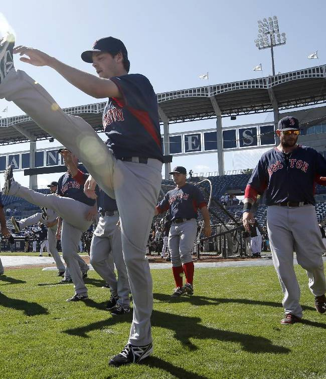 Members of the Boston Red Sox stretch and perform agility drills on the field before a spring exhibition baseball game against the New York Yankees in Tampa, Fla., Tuesday, March 18, 2014