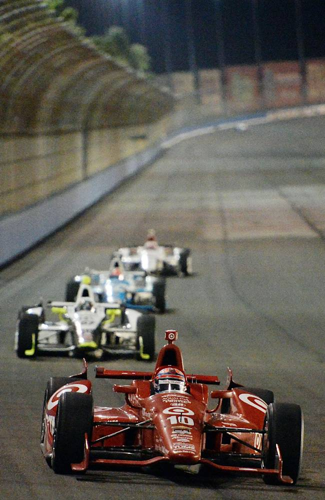 Tony Kanaan races into turn 3 during the IndyCar Series season final 500 mile auto race Saturday, Aug. 30, 2014, at Auto Club Speedway, in Fontana, Calif